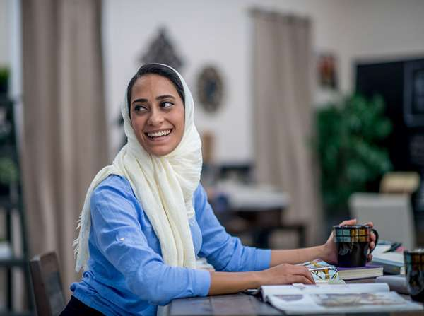 middle eastern refugee woman works at her office job