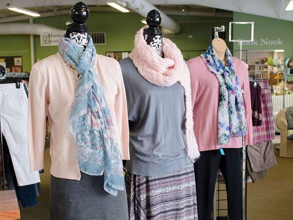 women's mannequins display pink and gray sweaters and scarves