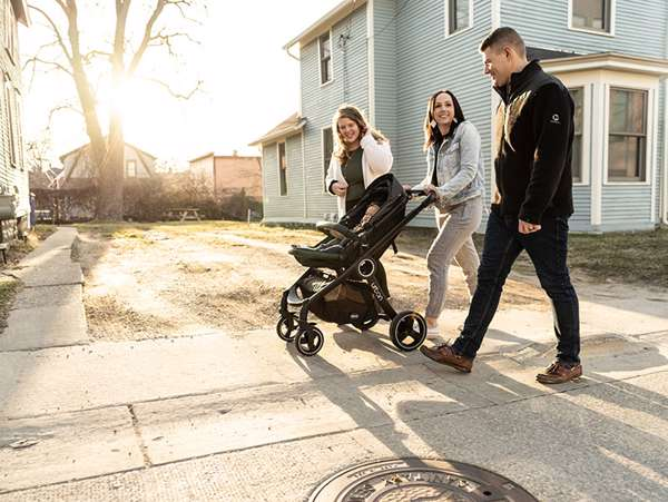 adoptive family takes a walk through their neighborhood