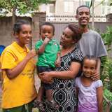 ethiopian family gathers in their yard